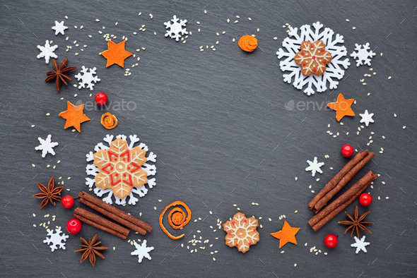Festive background with christmas cookies, snowflakes, cinnamon, - Stock Photo - Images