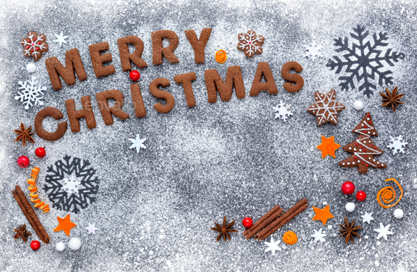 Merry Christmas cookies on a snowy flour with a dark background, - Stock Photo - Images