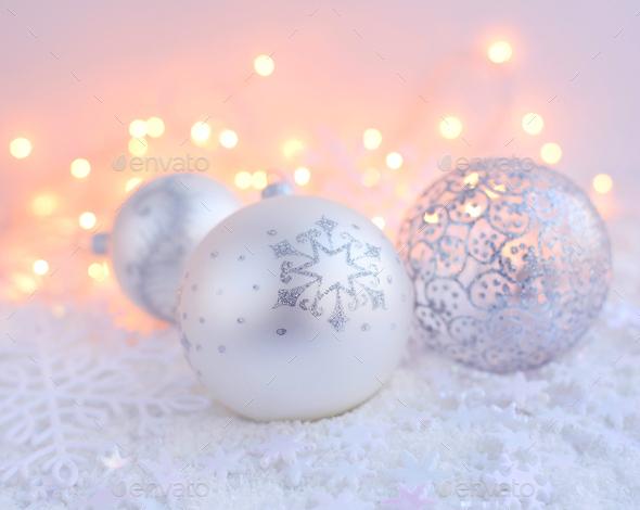Christmas decorative balls on snow and Christmas lights. Festive - Stock Photo - Images