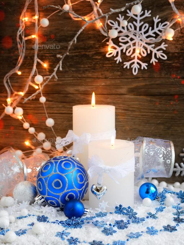 Christmas candles with Christmas ornaments and Christmas lights. - Stock Photo - Images