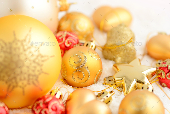 Christmas gold and red ornaments on the snow. Festive Christmas - Stock Photo - Images