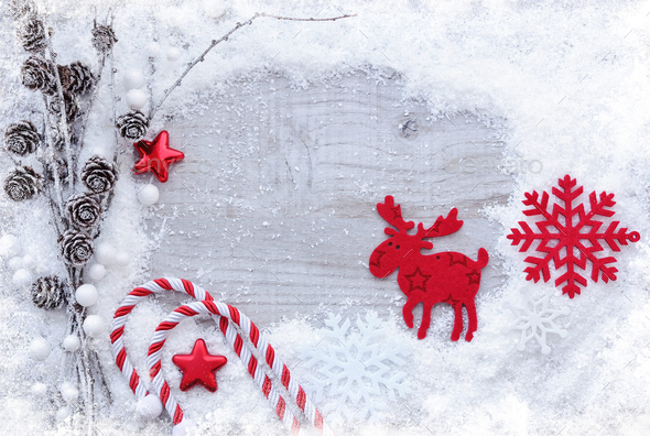 Greeting card with snow and christmas decorations on wooden back - Stock Photo - Images