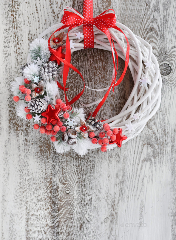 Christmas wreath with red ribbon on a vintage wooden background. - Stock Photo - Images