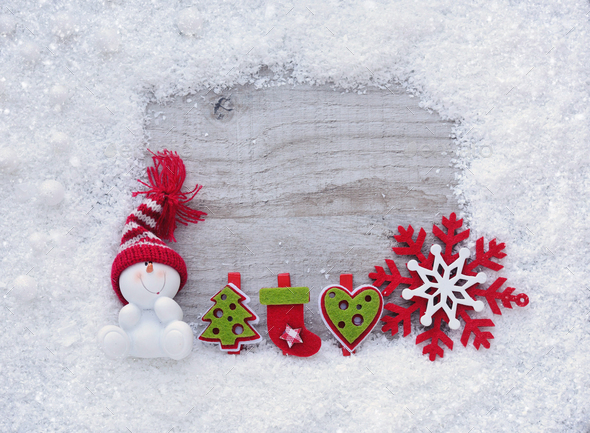 Frame of snow with snowmen and christmas decorations on wooden b - Stock Photo - Images