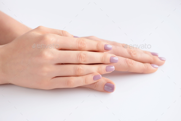 Closeup of hands of a young woman with pink manicure on nails ag - Stock Photo - Images