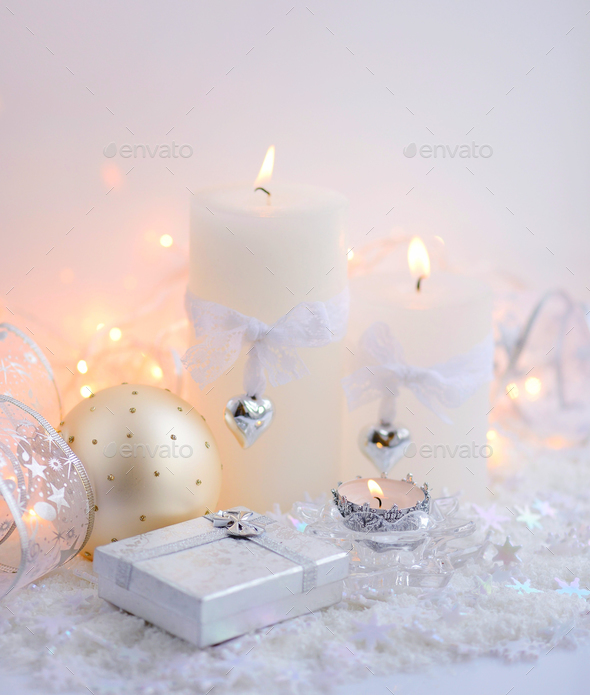 Christmas candles with Christmas baubles and Christmas lights. F - Stock Photo - Images