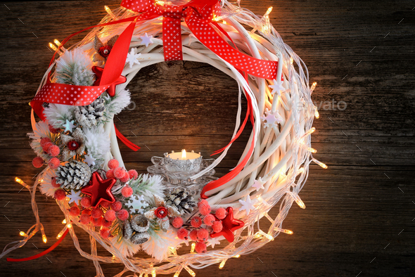 Candle with Christmas wreath and Christmas lights on a wooden ba - Stock Photo - Images