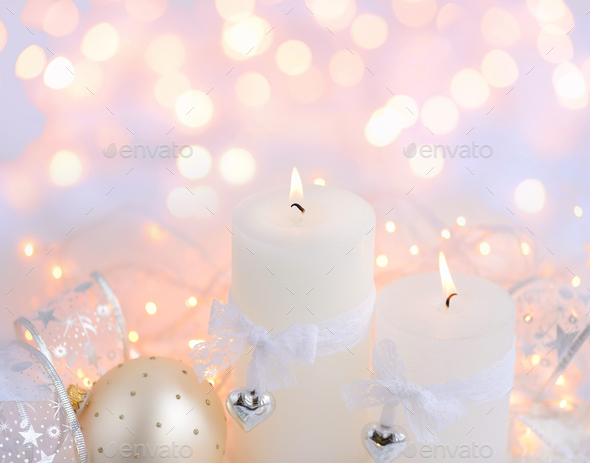 Christmas candles on the snow and Christmas lights. Festive Chri - Stock Photo - Images