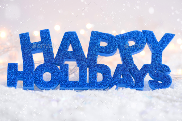 "Greeting ""Happy Holidays"" is on snow on a festive background - Stock Photo - Images"