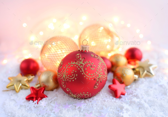 Christmas decorations on snow and Christmas lights. Festive Chri - Stock Photo - Images