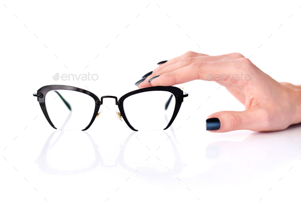Beautiful glasses whit female hand on white background - Stock Photo - Images