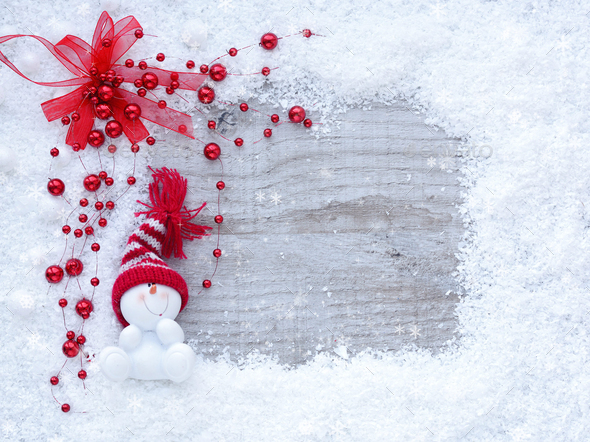 Frame of snow with snowmen on wooden background with space for y - Stock Photo - Images