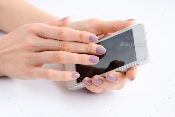 Women's hands holding mobile phone, hand touching phone screen - Stock Photo - Images