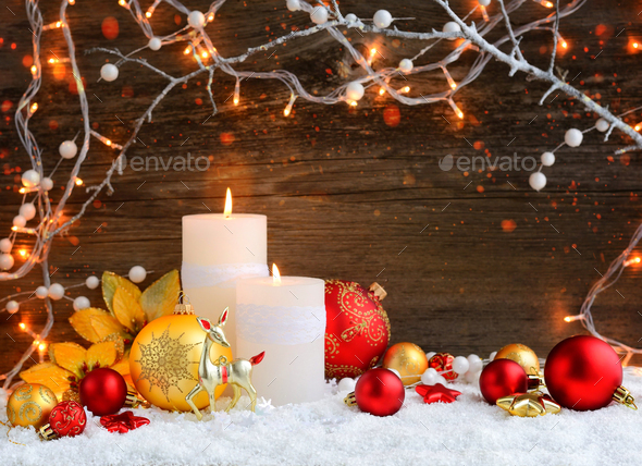 Christmas candles with Christmas ornaments and Christmas lights. - Stock Photo - Images