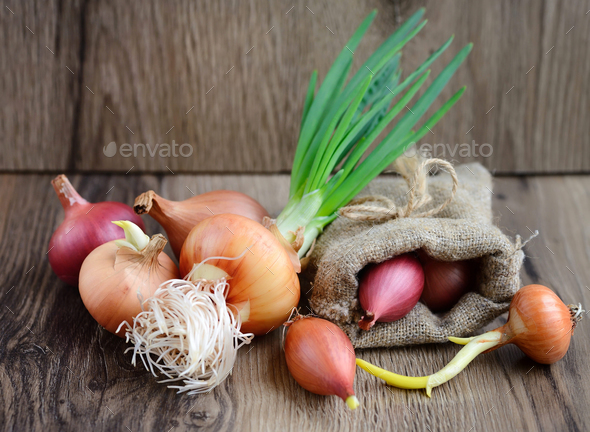 Colorful onions on rustic wooden background - Stock Photo - Images