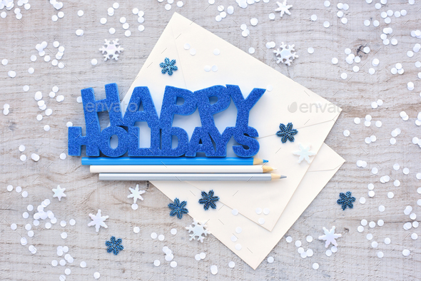 "Greeting ""Happy Holidays"", pencils, envelopes and snowflakes on - Stock Photo - Images"