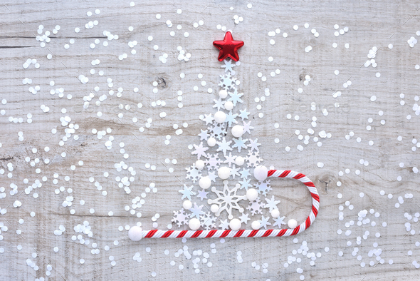 Christmas tree made of snowflakes on a light wooden background. - Stock Photo - Images