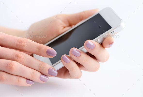 Women's hands holding mobile phone - Stock Photo - Images