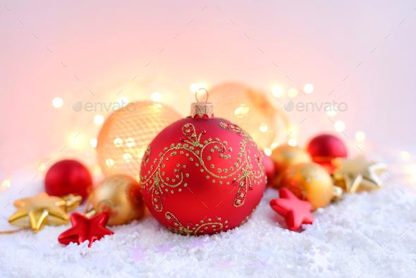 Christmas decorations on snow and Christmas lights. Festive Chri - Stock Photo - Images