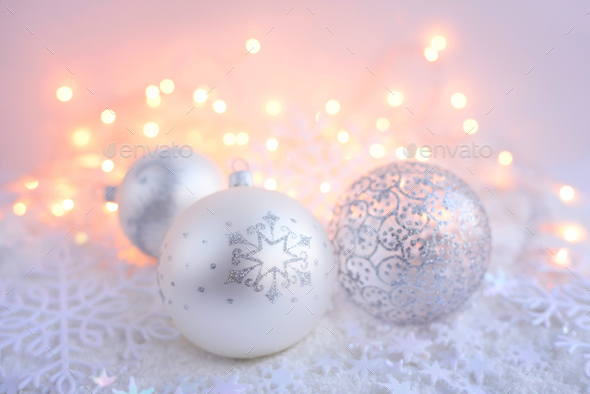 Christmas decorative balls on snow and Christmas lights. Festive - Stock Photo - Images