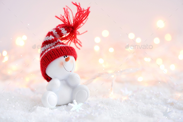 Festive Christmas background with snowman on the snow - Stock Photo - Images
