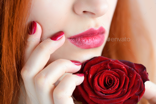 Portrait with red rose flower. Dark red lips and nails. Beautifu - Stock Photo - Images