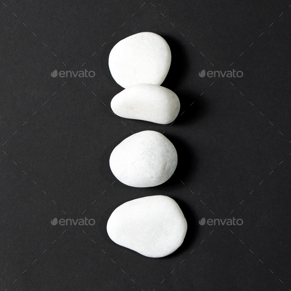 Four white pebbles - Stock Photo - Images
