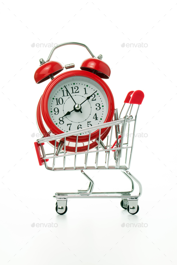 Red alarm clock in shopping cart - Stock Photo - Images