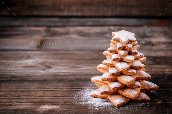 Homemade baked Christmas gingerbread tree with icing sugar - Stock Photo - Images