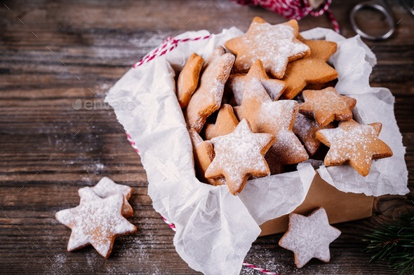 Homemade baked Christmas gingerbread cookies with icing sugar in the box - Stock Photo - Images