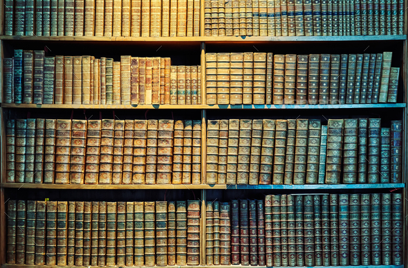 Vintage toned old books on wooden shelves. - Stock Photo - Images