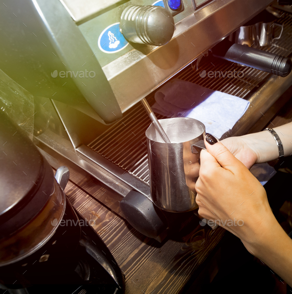 Preparing milk for coffee in coffee machine - Stock Photo - Images
