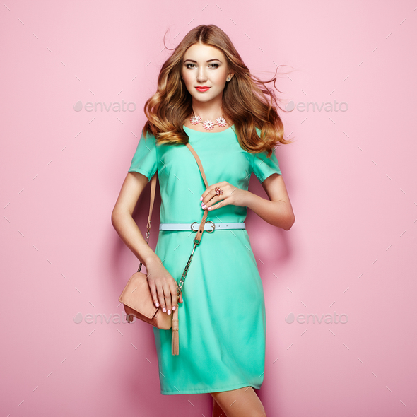 Blonde young woman in elegant green dress - Stock Photo - Images