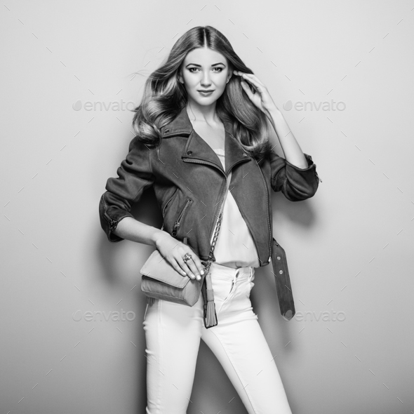 Black and white photo of young woman in leather jacket - Stock Photo - Images