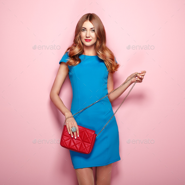 Blonde young woman in elegant blue dress - Stock Photo - Images