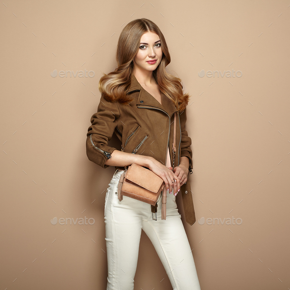 Young blond woman in brown jacket - Stock Photo - Images