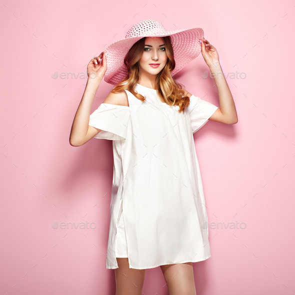Blonde young woman in summer white dress - Stock Photo - Images