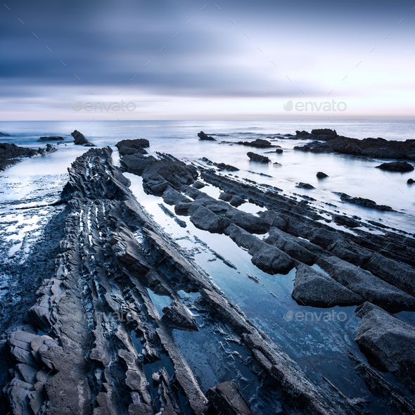Rocks in a sea on sunset. Tuscany coast. Italy - Stock Photo - Images