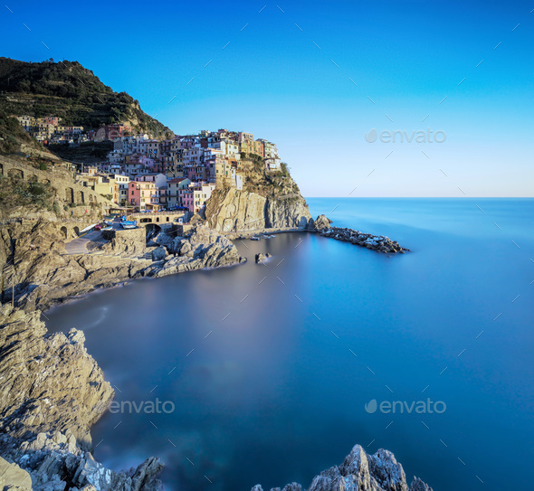 Manarola village, rocks and sea. Cinque Terre, Italy. Long Expos - Stock Photo - Images