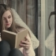 Beautiful Young Woman Reading Book - VideoHive Item for Sale