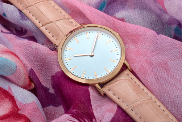 Wrist watch on colourful silk fabric background - Stock Photo - Images