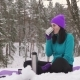Girl Drinks Hot Tea or Coffee Outdoors in Winter - VideoHive Item for Sale