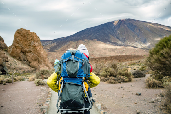 Super Mom with baby boy hiking in backpack - Stock Photo - Images