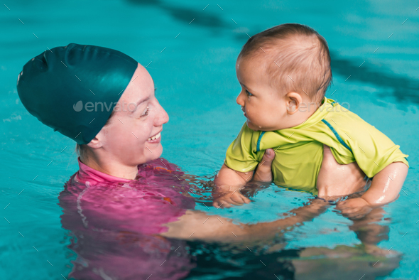 Baby swimming class - Stock Photo - Images