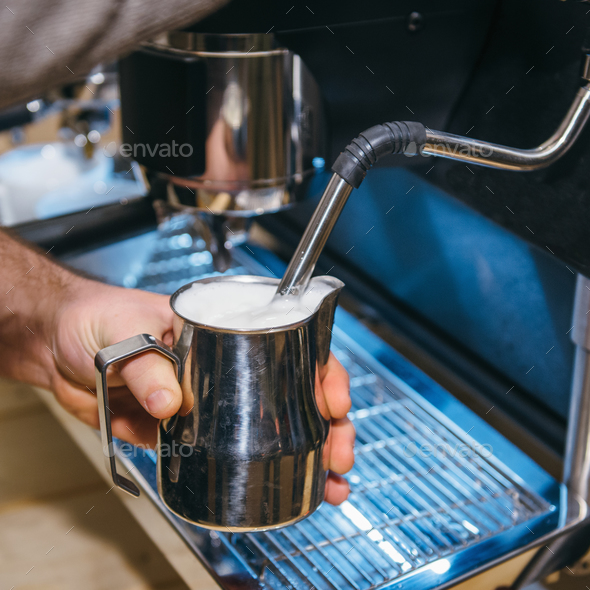 Making milk froth with espresso coffee machine - Stock Photo - Images