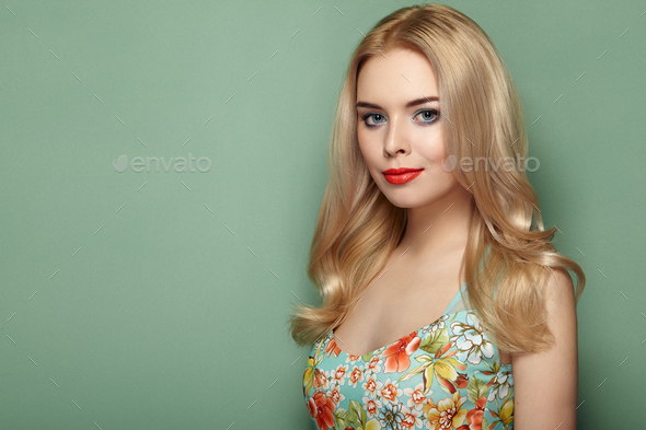 Blonde young woman in floral summer dress - Stock Photo - Images