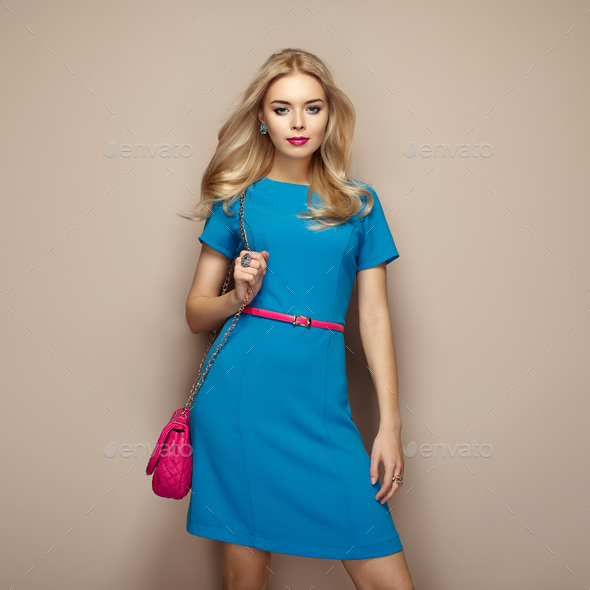 Blonde young woman in elegant blue summer dress - Stock Photo - Images