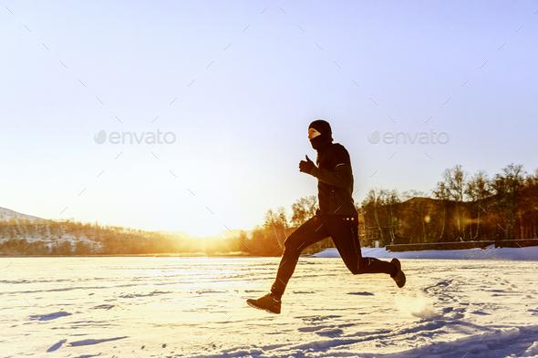 athlete runner running on snow - Stock Photo - Images