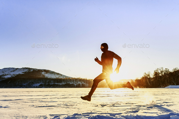 winter running male runner - Stock Photo - Images