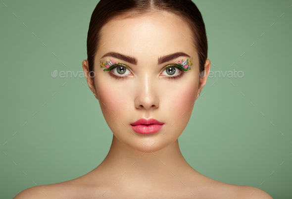 Young beautiful woman with flower makeup eyes - Stock Photo - Images